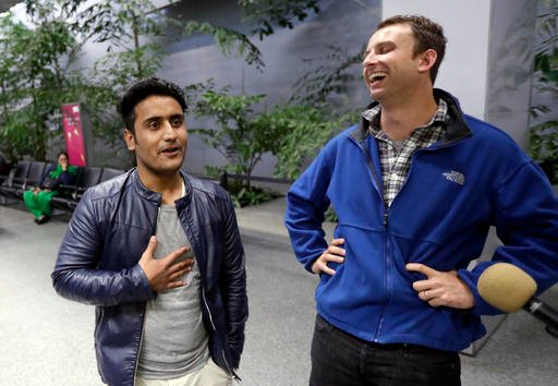 Army Capt. Matthew Ball, right, smiles next to his former interpreter Qismat Amin, after Amin arrived from Afghanistan, at San Francisco International Airport Wednesday, Feb. 8, 2017, in San Francisco.
