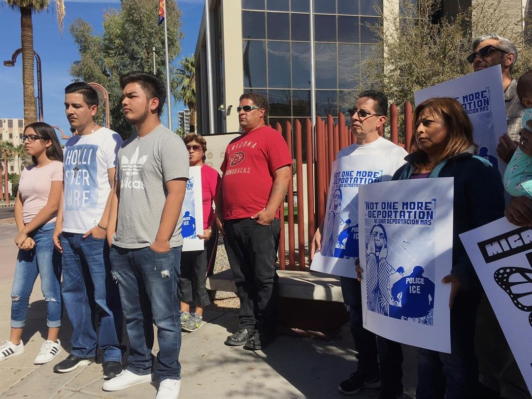 Members of the family of Guadalupe Garcia de Rayos, left, stand with supporters at a news conference in front of the U.S. Immigration and Customs Enforcement office in Phoenix. (AP Photo/Steve Fluty)