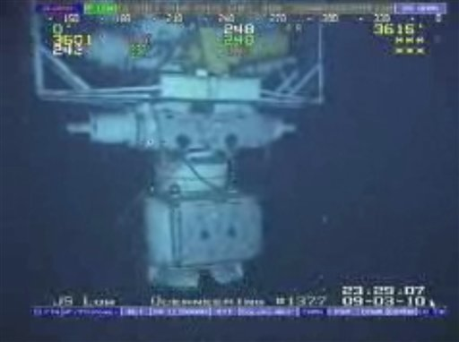 In this image taken from video provided by BP PLC at 12:23 a.m. EDT, Saturday Sept. 4, 2010 Aug. 3, 2010 shows the blowout preventer that failed to stop oil from spewing into the Gulf of Mexico being raised to the surface. (AP Photo/BP PLC)