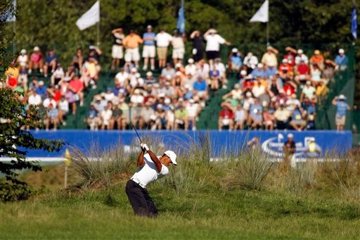 Tiger Woods hits his second shot on the ninth hole during the second round at the Deutsche Bank Championship golf tournament at TPC Boston, in Norton, Mass., Saturday, Sept. 4, 2010. (AP Photo/Stew Milne)