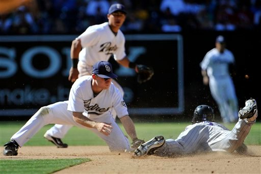 Colorado Rockies' Ryan Spilborghs, right, steals second base as San Diego Padres' David Eckstein, left, makes a late tag during the eighth inning of a baseball game Saturday, Sept. 4, 2010 in San Diego. (AP Photo/Denis Poroy)