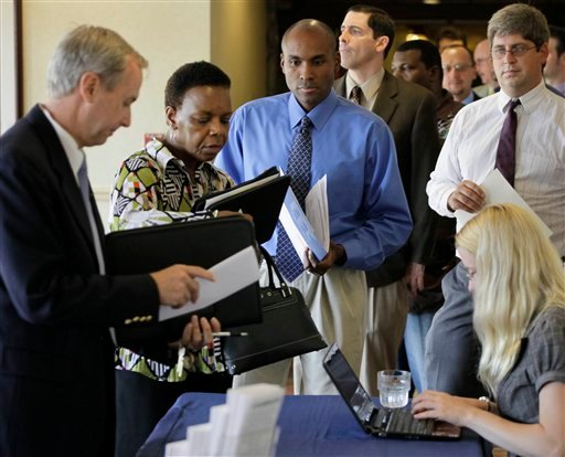 In this Aug. 31, 2010 file photo, job seekers supply copies of their resumes at a career fair in Rolling Meadows, Ill. (AP Photo/M. Spencer Green)