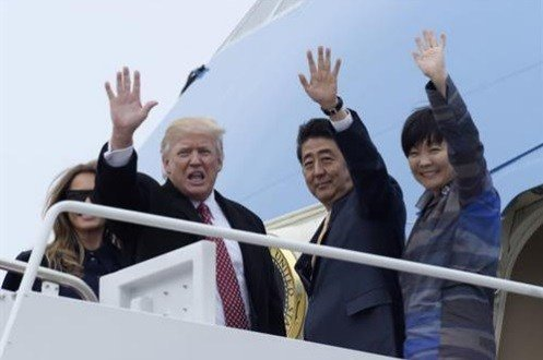 President Donald Trump and Japanese Prime Minister Shinzo Abe, accompanied by their wives, first lady Melania Trump and Akie Abe, wave before boarding Air Force One at Andrews Air Force Base Md.