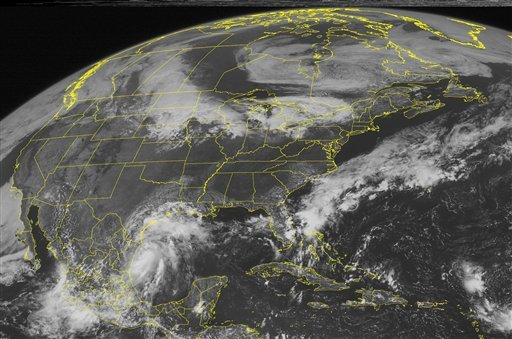 This NOAA satellite image taken Monday, Sept. 6, 2010 at 10:45 a.m. EDT shows clouds associated with Tropical Storm Hermine spinning in the western Gulf of Mexico. (AP PHOTO/WEATHER UNDERGROUND)