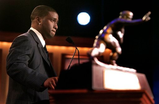 In this Dec. 10, 2005, file photo, Southern California tailback back Reggie Bush pauses while giving his acceptance speech as the winner of the Heisman Trophy award in New York.