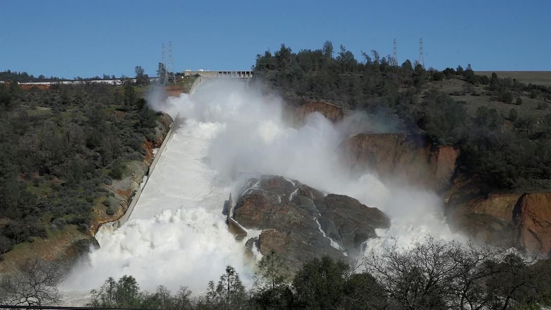 A photo from Saturday shows watering flows down Oroville Dam's main spillway near Oroville, Calif. (AP Photo/Rich Pedroncelli)