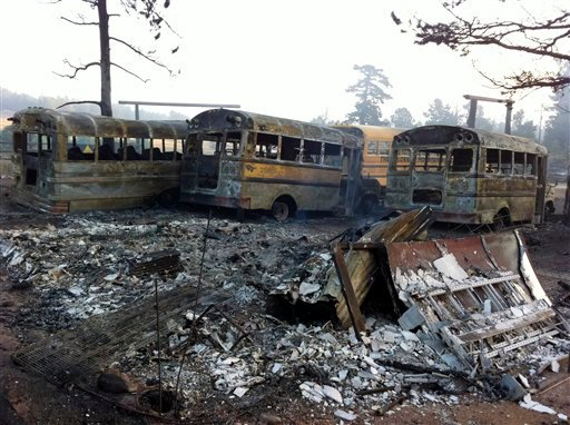 In this photo provided by Eric Peter Abramson, a line of buses are destroyed after a wild fire passed through Gold Hill, Colo. on Tuesday, Sept. 7, 2010. (AP Photo/Eric Peter Abramson)