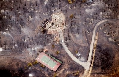A home destroyed by a wildfire is shown in an aerial photo over Boulder, Colo., Wednesday, Sept. 8, 2010.