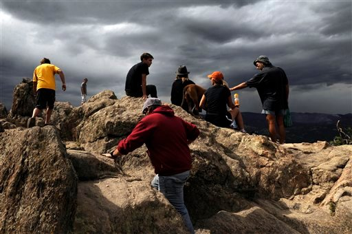 People gather on an overlook in order to get a view of a wildfire that burns outside of Boulder, Colo. on Wednesday Sept. 8, 2010. (AP Photo/ Matt McClain)