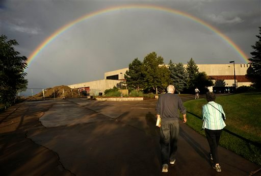 A rainbow extends over the Coors Events Center on the campus of the University of Colorado as the public arrives for a town hall style meeting to address questions about a wildfire outside of Boulder, Colo. On Sept. 8, 2010. (AP Photo/ Matt McClain)
