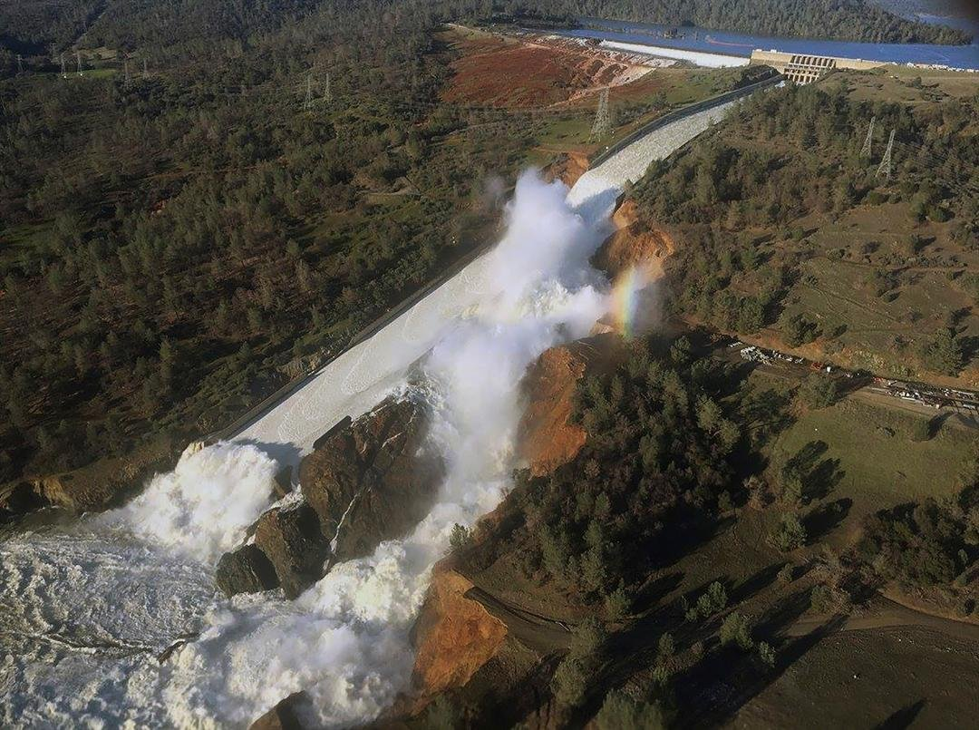 This Saturday, Feb. 11, 2017, aerial photo released by the California Department of Water Resources shows the damaged spillway with eroded hillside in Oroville, Calif. (William Croyle/California Department of Water Resources via AP)