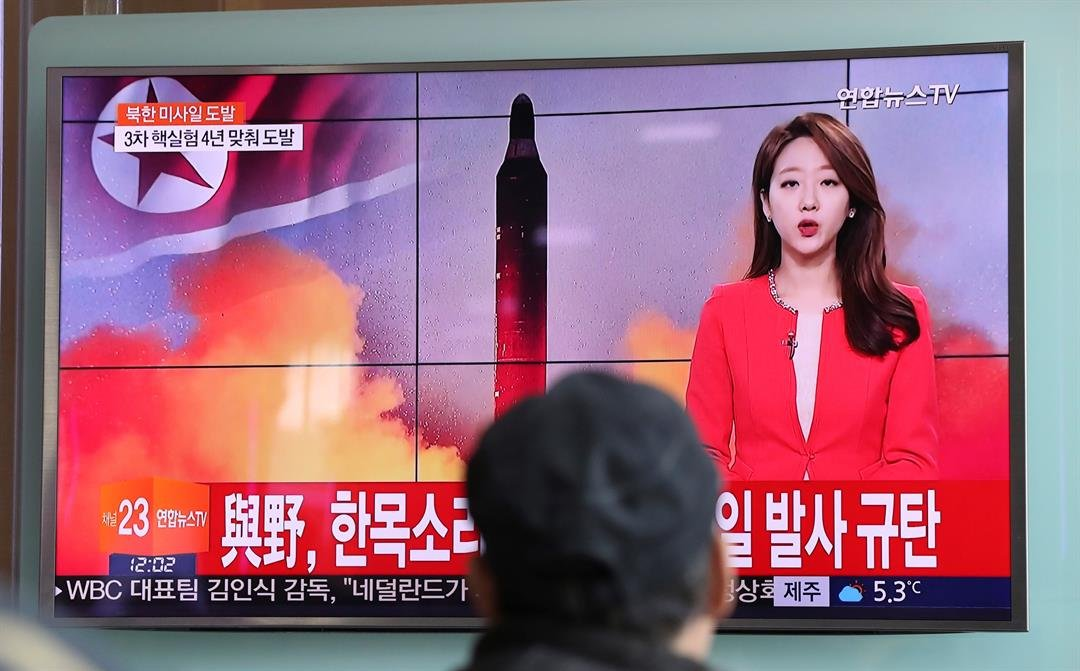 "Details of the launch, including the type of missile, were scant. The letters read ""The ruling and the opposition parties denounce North Korea's missile launch."" (AP Photo/Lee Jin-man)"