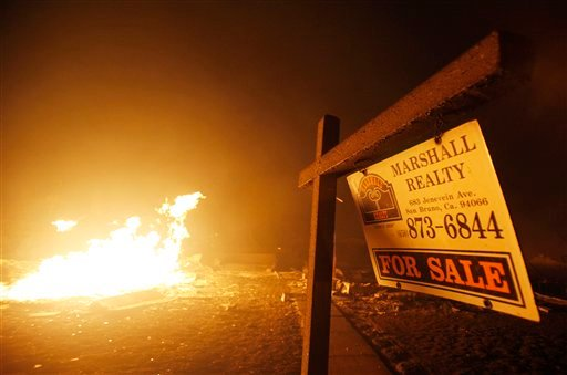 A home for sale sign is shown in front of home that was destroyed after a massive fire that roared through a mostly residential neighborhood in San Bruno, Calif., Thursday, Sept. 9, 2010. (AP)