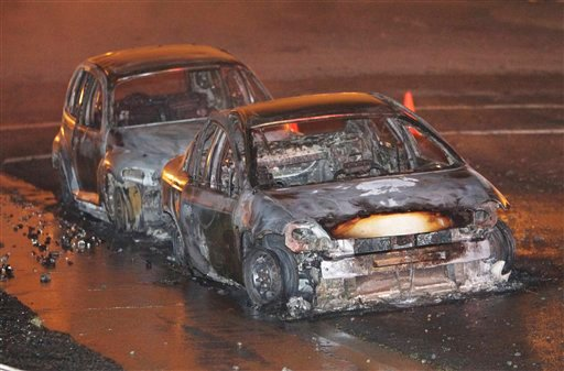 Two cars burned after a massive fire roared through a mostly residential neighborhood in San Bruno, Calif., Thursday, Sept. 9, 2010. (AP)