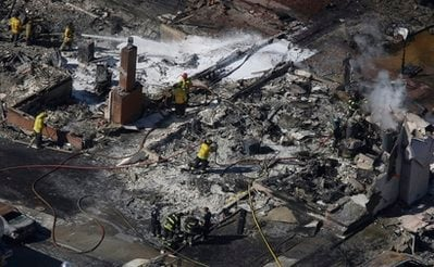 Firemen work on the remains of a home damaged by a massive fire in a mostly residential neighborhood in San Bruno, Calif., Friday, Sept. 10, 2010.