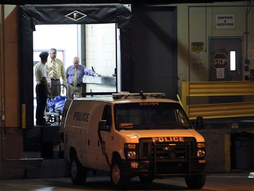 Police remove the victim's bodies from the scene of a workplace shooting at the Kraft Foods Inc. facility in Northeast Philadelphia on Thursday Sept. 10, 2010. (AP Photo/ Joseph Kaczmarek)