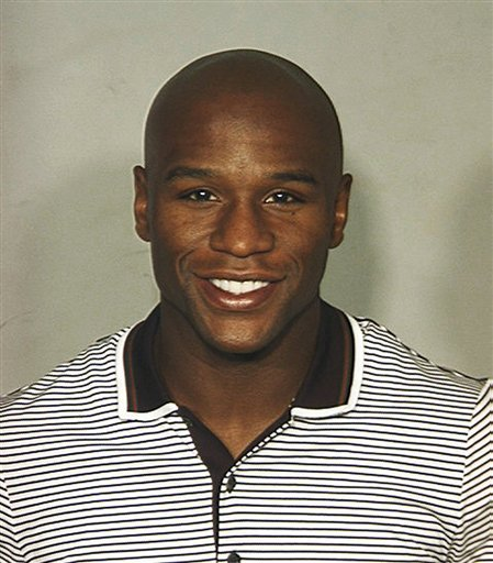 This undated booking photo provided by the Las Vegas Metropolitan Police Department shows boxer Floyd Mayweather Jr. Mayweather was arrested in Las Vegas on a felony theft charge stemming from a domestic violence complaint by his ex-girlfriend.