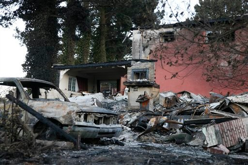 A burned home and car is shown in a neighborhood damaged by a gas explosion in San Bruno, Calif., Friday, Sept. 10, 2010. (AP Photo/Eric Risberg, Pool)
