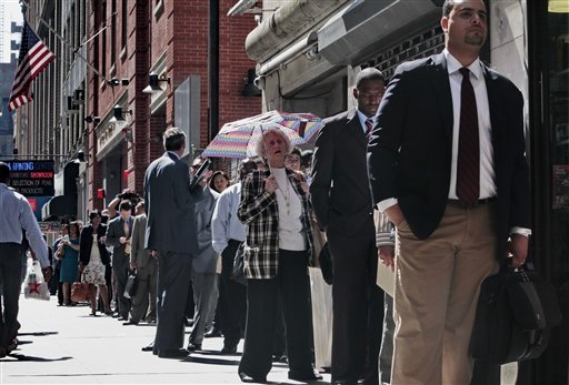In this June 2, 2010 file photo, job seekers wait on line to see potential employers at the Diversity Job Fair in New York. (AP Photo/Bebeto Matthews, File)