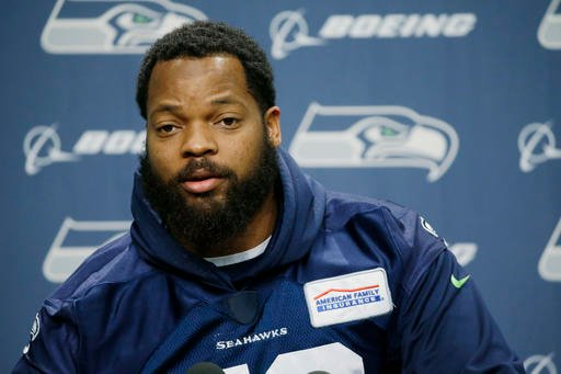 In this Jan. 10, 2017 file photo, Seattle Seahawks defensive end Michael Bennett talks to reporters, in Renton, Wash.