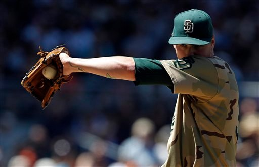 San Diego Padres starting pitcher Mat Latos wipes his face after walking San Francisco Giants starting pitcher Tim Lincecum during the second inning of a baseball game in San Diego, Sunday, Sept. 12, 2010. (AP Photo/Chris Carlson)