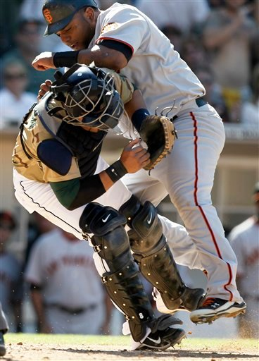 San Francisco Giants' Pablo Sandoval, right, is tagged out at home by San Diego Padres catcher Yorvit Torrealba while trying to score on a single by Juan Uribe during the eighth inning of a baseball game in San Diego, Sunday, Sept. 12, 2010. (AP Photo)