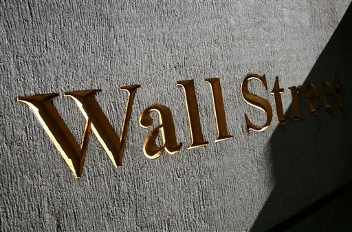 In this March 8, 2010 file photograph, a sign for Wall Street is shown near the New York Stock Exchange. (AP Photo/Mark Lennihan, file)