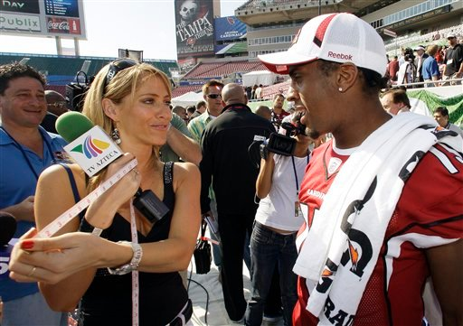 This Jan. 27, 2009, file photo shows TV Azteca reporter Ines Sainz, left, after measuring the bicep of Arizona Cardinals wide receiver Steve Breaston, right, during the team's media day for Super Bowl XLIII, in Tampa, Fla.
