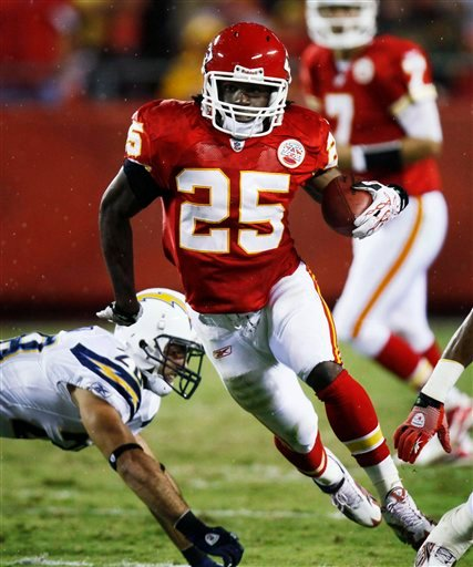 Kansas City Chiefs running back Jamaal Charles (25) gets past San Diego Chargers  safety Steve Gregory (28) on his way to a touchdown during the first half of an NFL football game Monday, Sept. 13, 2010, in Kansas City, Mo. (AP Photo/Ed Zurga)