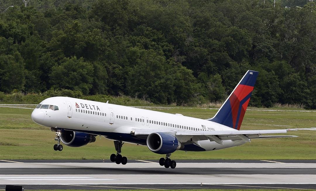 FILE - In this Thursday, May 15, 2014, file photo, a Delta Air Lines Boeing 757-232 lands at the Tampa International Airport in Tampa, Fla. (AP Photo/Chris O'Meara, File)