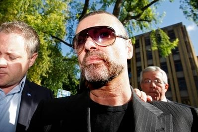 British singer George Michael arrives at Highbury Corner Magistrates Court in north London for his hearing on charge with driving under the influence of drugs after he smashed his car into a high street shop, Tuesday, Aug. 24, 2010.