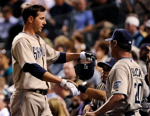 San Diego Padres' Jon Garland is congratulated by teammates after scoring against the Colorado Rockies during the fourth inning of a baseball game in Denver, Tuesday, Sept. 14, 2010. (AP Photo/Jack Dempsey)