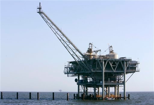 In this file photo taken April 13, 2007, a natural gas platform is shown off the coast of Fort Morgan, Ala. (AP Photo/Rob Carr, file)