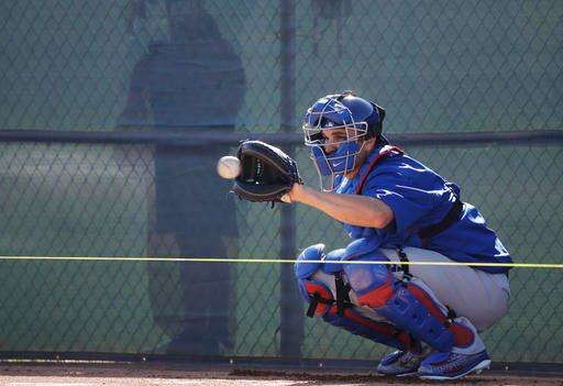 In this Feb. 14, 2017, file photo, Chicago Cubs catcher Miguel Montero catches a ball during a spring training baseball workout in Mesa, Ariz.