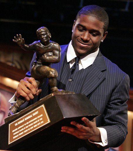 In this Dec. 10, 2005, file photo, Southern California tailback Reggie Bush picks up the Heisman Trophy after being announced as the winner of the award in New York.