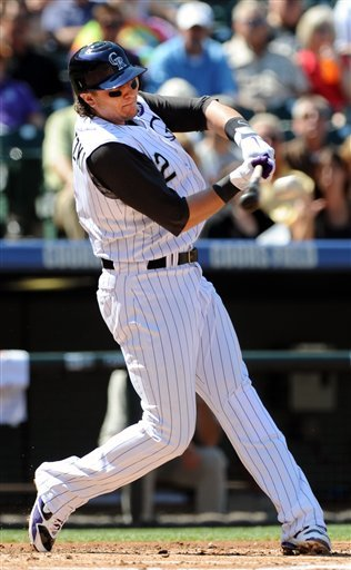 Colorado Rockies' Troy Tulowitzki hits an RBI single in the first inning of a baseball game against the San Diego Padres at Coors Field in Denver on Wednesday, Sept. 15, 2010. (AP Photo/Chris Schneider)