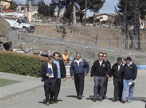 Calif. Gov. Arnold Schwarzenegger, center, tours the site of a pipeline explosion in San Bruno, Calif., Wednesday, Sept. 15, 2010 that exploded last Thursday. Second from right is Lt. Gov. Abel Maldonado. (AP Photo/Paul Sakuma)