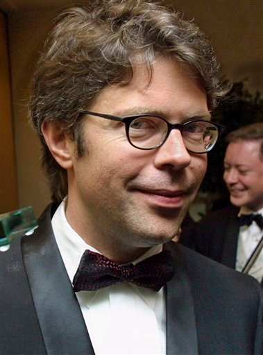 In a Nov. 14, 2001 photo, novelist Jonathan Franzen poses with his National Book Award after the 2001 National Book Foundation's awards ceremony in New York.