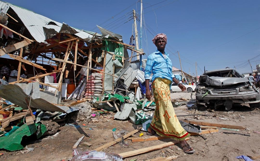 A man walks past the wreckage of shops destroyed by a blast in a market in the capital Mogadishu, Somalia, on Sunday. (AP Photo/Farah Abdi Warsameh)