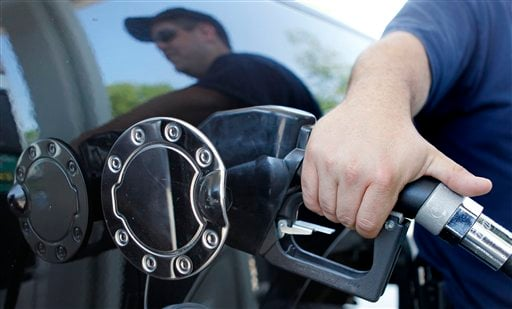 In this May 26, 2010 file photo, Kevin Stearns of Oxford, Mass., fills up his pick up truck at a gas station in Milford, Mass. (AP Photo/Charles Krupa, file)