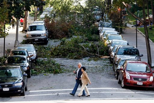 Residents cross 68th Drive in front of fallen trees at the intersection of Yellowstone Blvd. in the Queens borough of New York on Friday, Sept. 17, 2010, the day the after severe storm tore through New York City.