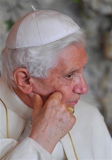Pope Benedict XVI listens at a meeting of religious leaders at St Mary's University College Chapel at Twickenham in west London, Friday, Sept. 17, 2010. The Pope is on a four-day visit to England and Scotland. (AP Photo/Toby Melville. Pool)