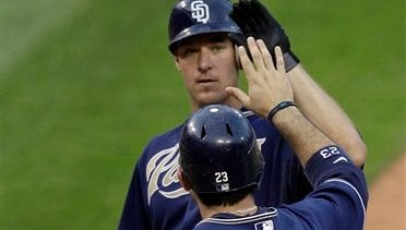 San Diego Padres' Ryan Ludwick, top, is congratulated by teammate Adrian Gonzalez after hitting a three-run home run during the ninth inning of a baseball game against the St. Louis Cardinals, Saturday, Sept. 18, 2010, in St. Louis. (AP)