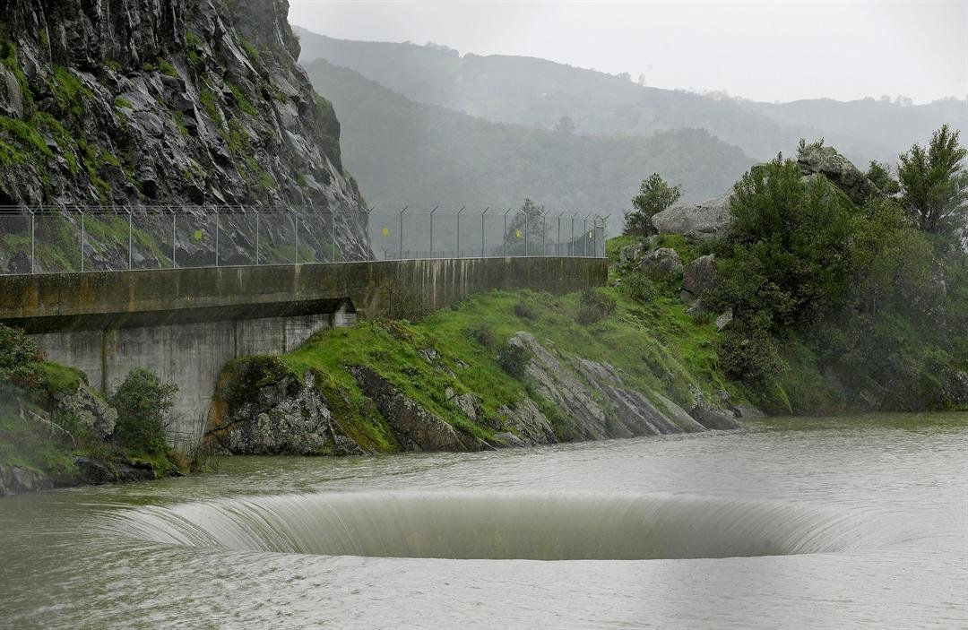 Water flows into the iconic Glory Hole spillway at Monticello Dam Monday, Feb. 20, 2017, in Lake Berryessa, Calif. Water is flowing for the first time in a over a decade into the 72-foot diameter hole due to the recent storms in California. (AP Photo/Eric