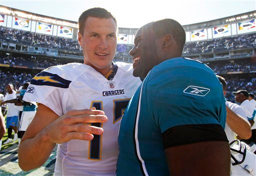 San Diego Chargers quarterback Philip Rivers, left, talks with Jacksonville Jaguars quarterback David Garrard, right, after an NFL football game Sunday, Sept. 19, 2010. The Chargers won 38-13. (AP Photo/Denis Poroy)
