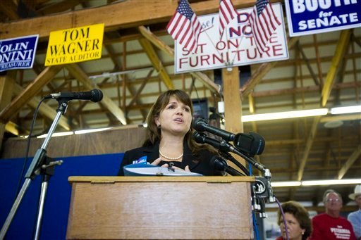 Delaware Republican Senate candidate Christine O'Donnell speaks at a Sussex County Republican Committee Picnic at Dave Wilson's Auction on Sunday, Sept. 19, 2010, in Lincoln, Del. (AP Photo/Jessica Kourkounis)