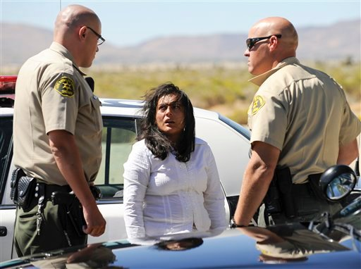 Reyna Chicas, the leader of a breakaway religious sect, is taken in for questioning after her group was located by Los Angeles County Sheriffs officers at Jackie Robinson Park, outside Palmdale in Littlerock, Calif., Sunday, Sept. 19, 2010.  (AP Photo)