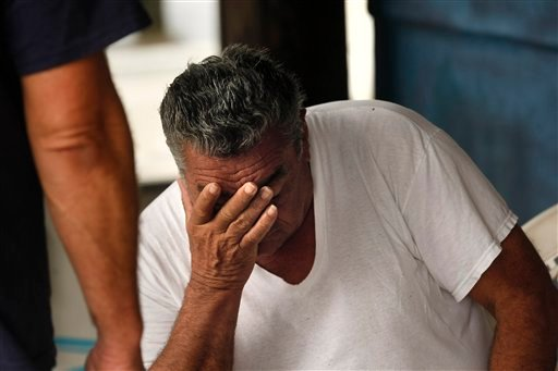 In this May 1, 2010 file photo, Frank Campo, owner of Campo Marina, pauses as he discusses the threats to the region and his livelihood from the oil spill from the Deepwater Horizon rig at his Marina. (AP Photo/Gerald Herbert, File)