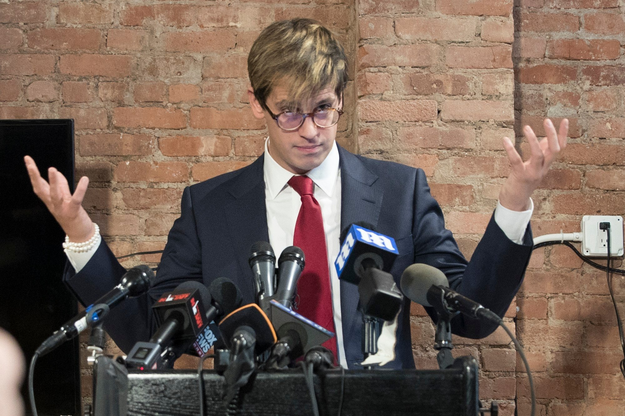 Milo Yiannopoulos speaks during a news conference (AP Photo/Mary Altaffer)