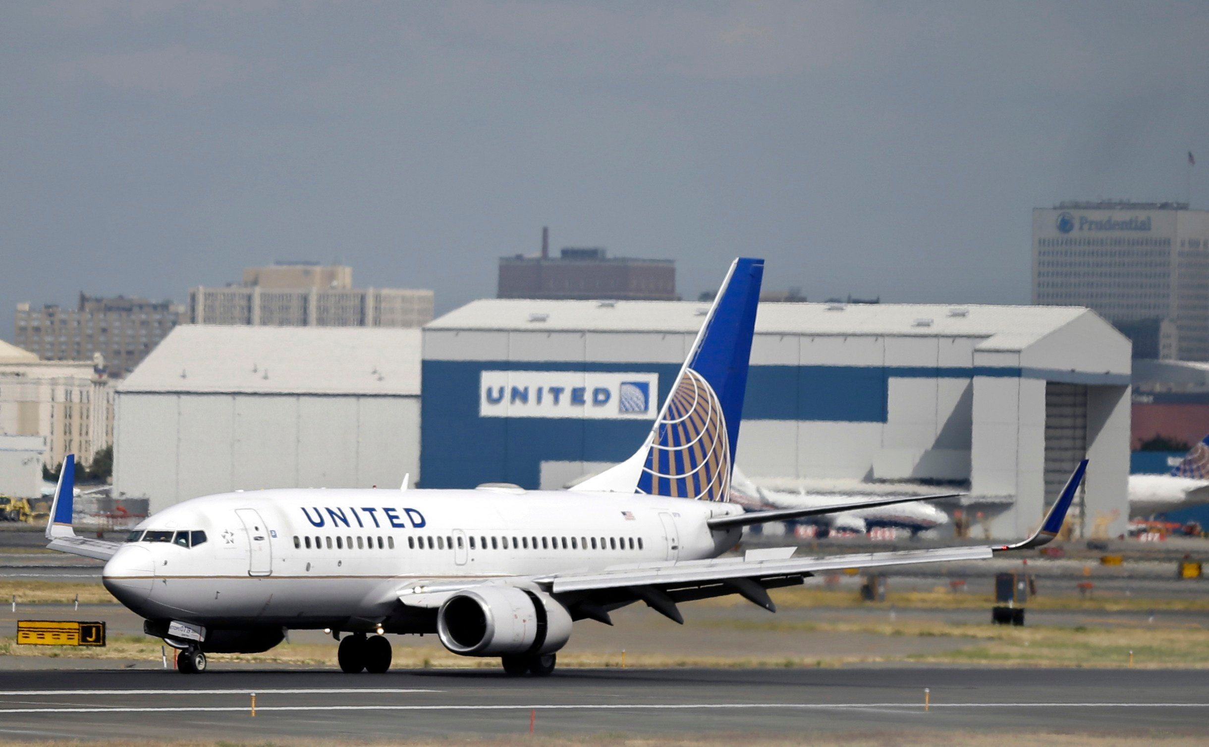 FILE - In this Sept. 8, 2015 file photo, a United Airlines passenger plane lands at Newark Liberty International Airport in Newark, N.J. United Airline fliers will soon get the chance to buy cheaper fares on some of the airline's flights.  (AP Photo/Mel E